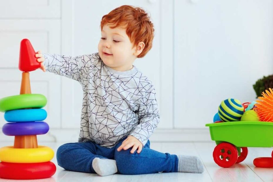 toddler playing cause and effect toys