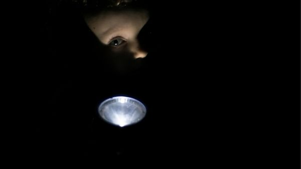 toddler playing with flashlight
