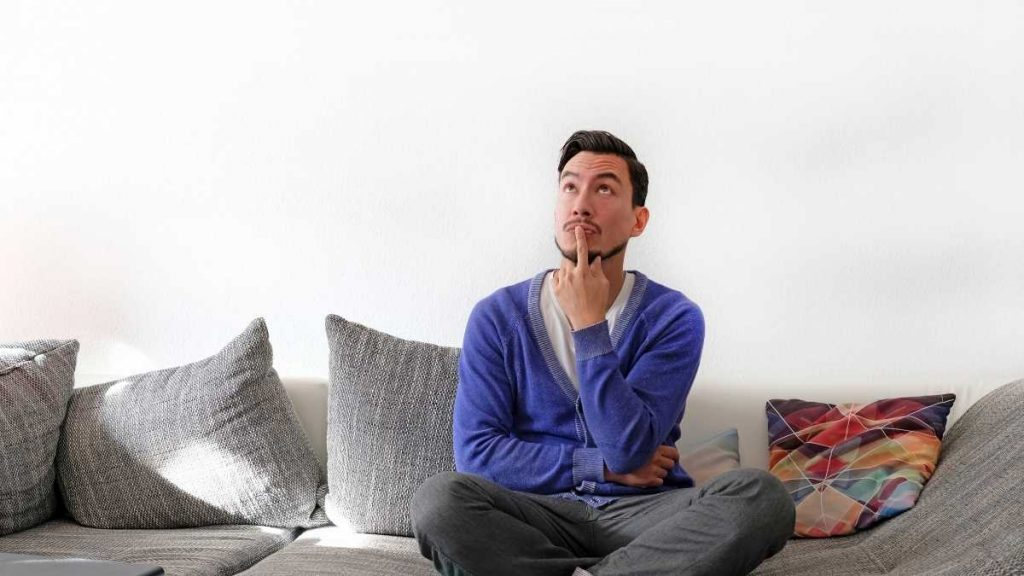husband on couch considering options