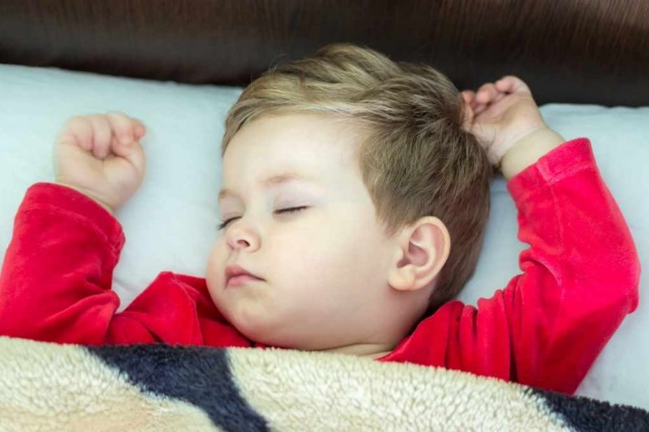 toddler sleeping with arms in the air